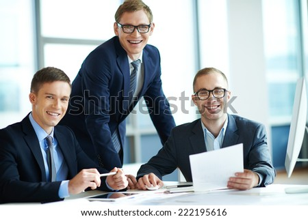Three businessmen smiling at camera - stock photo