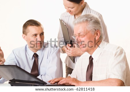 Three businessmen working together on a white - stock photo