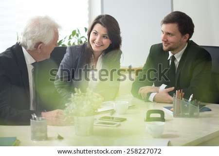 Three businesspeople during debate in conference room - stock photo
