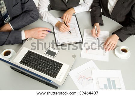 Three businesspeople on a meeting. Close-up