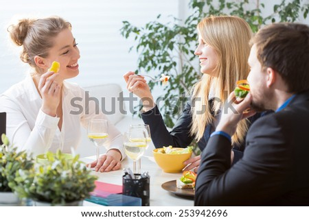 Three businesspeople on their brunch during conference - stock photo