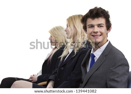 Three Businesspeople Sitting In A Row Over White Background