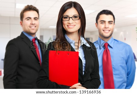 Three businesspeople welcoming you - stock photo