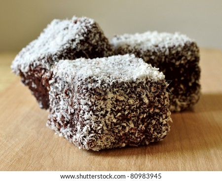 Three cakes with coconuts - stock photo