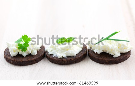 three canape with cheese and herbs