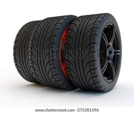 three car tires with one pushed forward on a unique red disk - stock photo