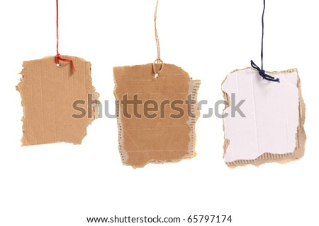 three cardboard tags hanging on white background - stock photo