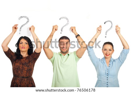 Three casual people standing in a line and holding questions marks  over their heads isolated on white background - stock photo