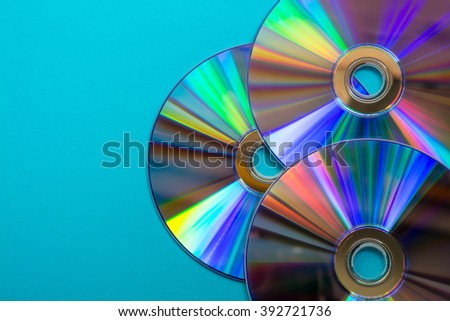 Three CD on blue background - stock photo