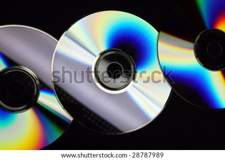 Three CD's forming a colorful line