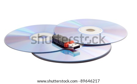 three CDs and USB flash drive, on a white background - stock photo