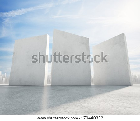 Three cement blank banners and city on horizon - stock photo
