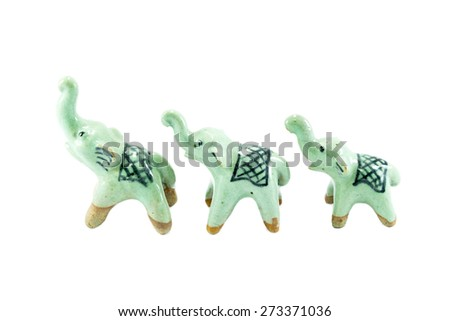 three ceramic elephant on the white background - stock photo