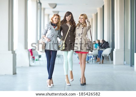 Three cheerful ladies walking in the first day of spring - stock photo