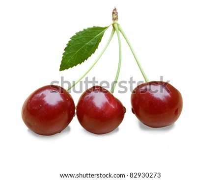 three cherries isolated on a white background