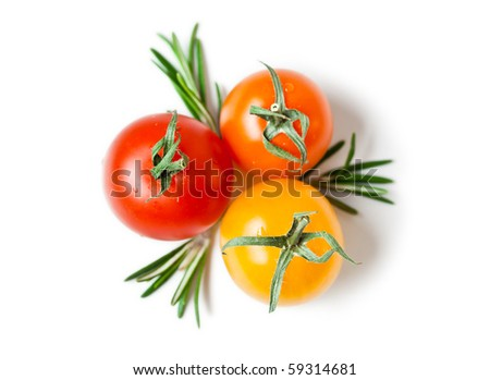 three cherry tomatoes with rosemary from above on white - stock photo