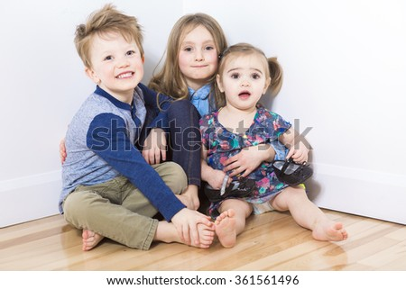 three child sit on the floor at home - stock photo