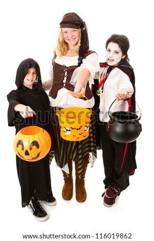 Three children of various ages dressed for Halloween.  Full body isolated on white. - stock photo