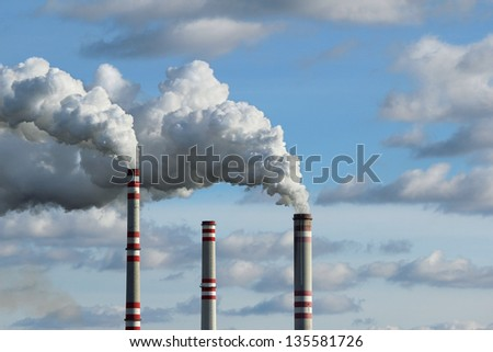 three chimney and white smoke polluted sky - stock photo