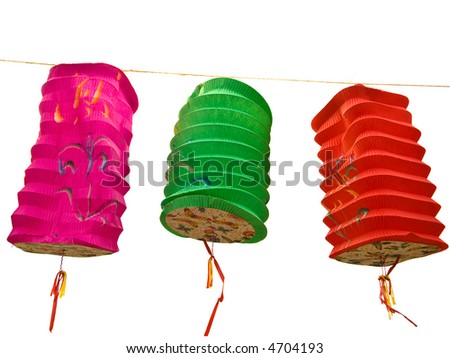 Three Chinese paper lanterns hovering in the wind, over white - stock photo