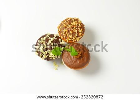 three chocolate muffins on white background - stock photo