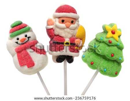 Three Christmas and new year sweets : Christmas tree, Santa Claus and Snowman. Isolated on white background. - stock photo