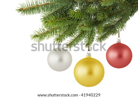 Three Christmas balls hanging on a spruce branch. - stock photo