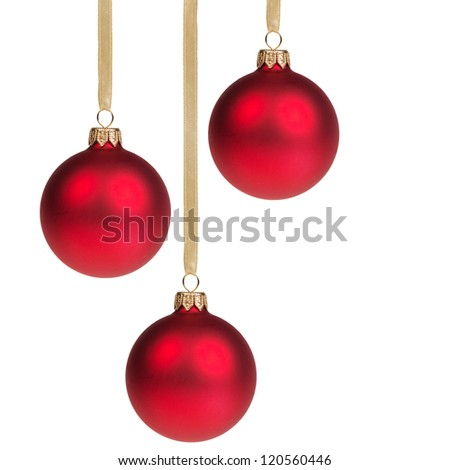 three christmas balls hanging on ribbon isolated on white - stock photo