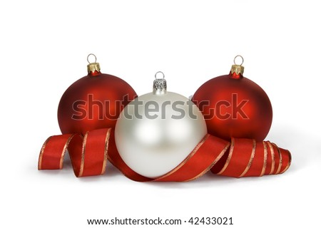 Three Christmas balls with red ribbon on white. Clipping path included. - stock photo