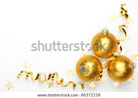 Three christmas balls with ribbon and confetti stars on white background. - stock photo