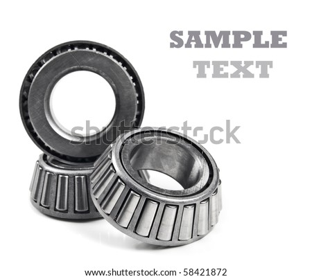 Three chrome ball bearings stacked up on a white background with space for text - stock photo