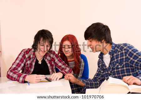 Three classmates using a smartphone