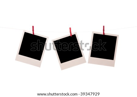 three clear photos pined with clothespin hanging on a cord isolated on white background