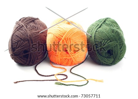 Three clews of woolen yarn over pure white background