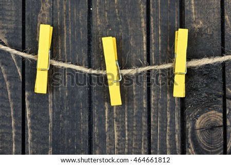 Three clips on wooden wall