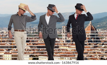 Three clones or triplets in Florence, Italy - stock photo