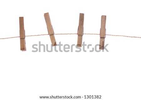 three clothespins on rope (isolated)