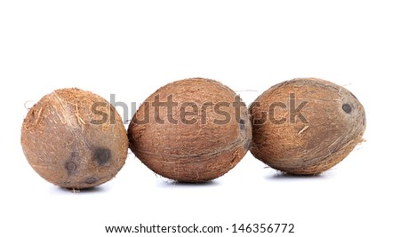 Three coconuts isolated on a white background - stock photo