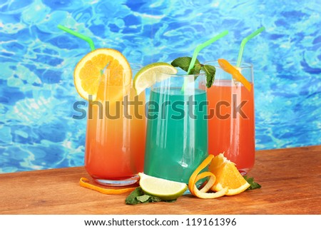 Three coctails on blue background