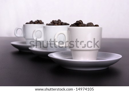 three coffee cups icolated on white