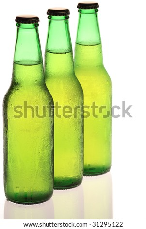 Three cold bottles of beer in a row on a white background
