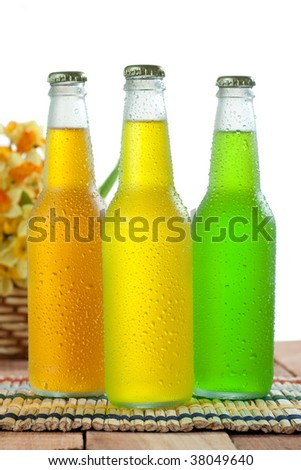 Three cold drink on wooden table on white background