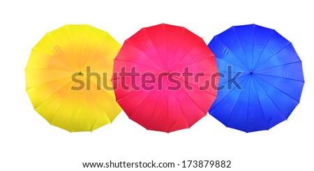three color umbrella on a white background - stock photo