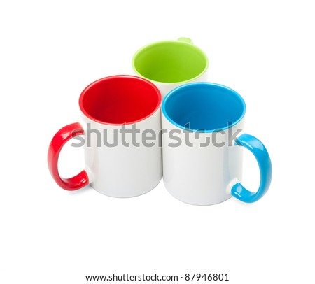 three colored cups on white background - stock photo