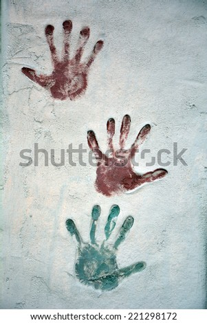 Three Colored Hands Print  - stock photo
