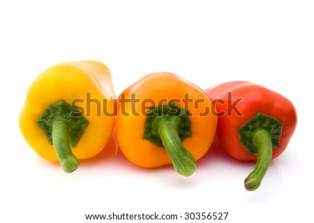 Three colored paprika on a white background