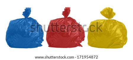 Three colored rubbish bags on white background - stock photo