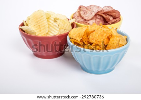 Three Colorful Bowls of Potato Chips of Various Flavors - stock photo