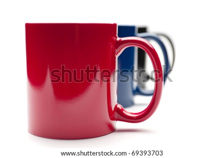 three colorful cups on a white background - stock photo