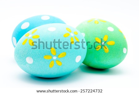 Three colorful handmade easter eggs isolated on a white - stock photo
